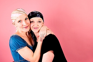 Two breast surgical oncology patients embracing.