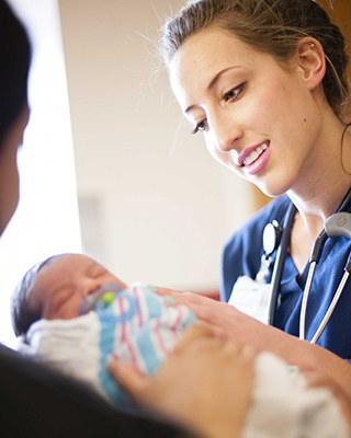 PRESious Beginnings nurse completing a risk screening on a baby.